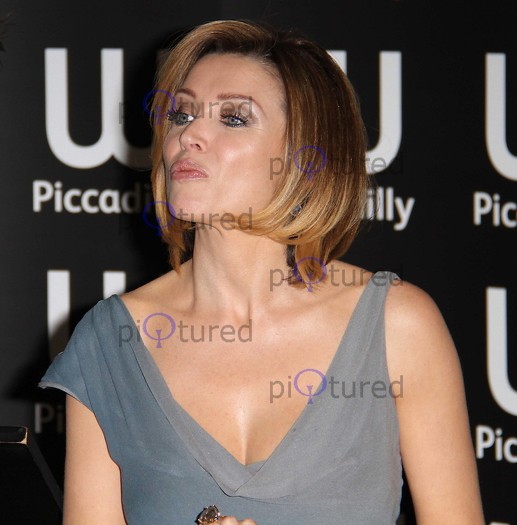 Dannii Minogue My Story - book signing at Waterstone's Book Store, Piccadilly, London, UK, 29 October 2010: For piQtured Sales contact: Ian@Piqtured.com +44(0)791 626 2580 (picture by Richard Goldschmidt)
