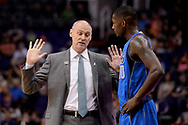 Apr 9, 2017; Phoenix, AZ, USA; Dallas Mavericks head coach Rick Carlisle talks with forward Dorian Finney-Smith (10) on the sidelines in the first half of the NBA game against the Phoenix Suns at Talking Stick Resort Arena. Mandatory Credit: Jennifer Stewart-USA TODAY Sports