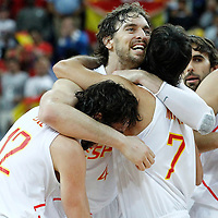 10 August 2012: Spain Pau Gasol celebrates the win with Juan Carlos Navarro and Sergio Llull following the 67-59 Team Spain victory over Team Russia, during the men's basketball semi-finals, at the North Greenwich Arena, in London, Great Britain.