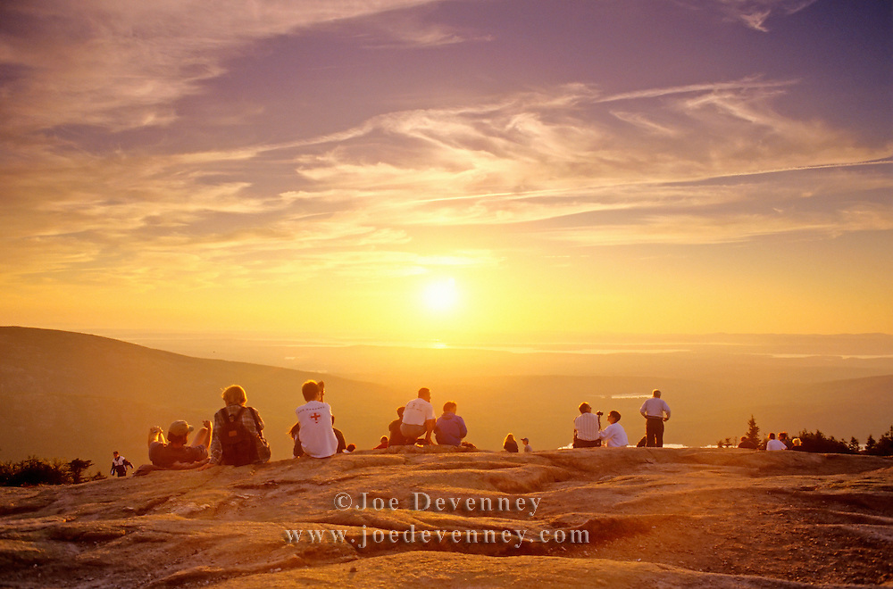 People watching the sunset over Blue Hill Bay. Cadillac Mountain. Acadia National Park