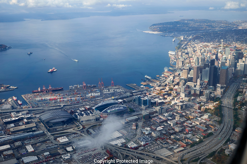 Flying over Seattle Washington with CenturyLink field, Safeco Field, downtown and Elliott bay visible Wednesday, Nov. 1, 2017. (Photo/John Froschauer)