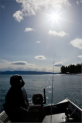 """Fishing on Lake Tahoe"" - This fisherman on Lake Tahoe ended up catching a Mackinaw this day."