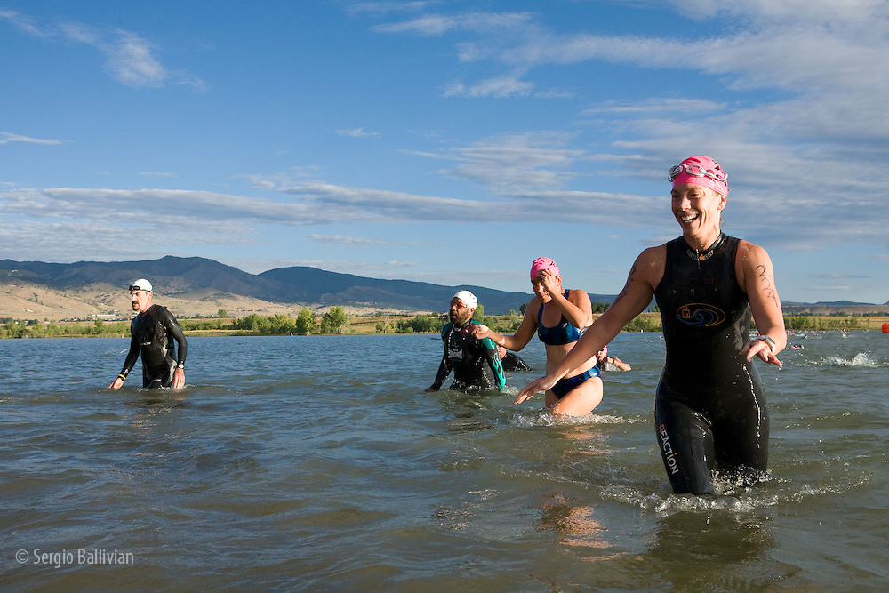 Swimmers coming out of the water after finishing the swimming portion of the 5430 Triathlon in Boulder, CO