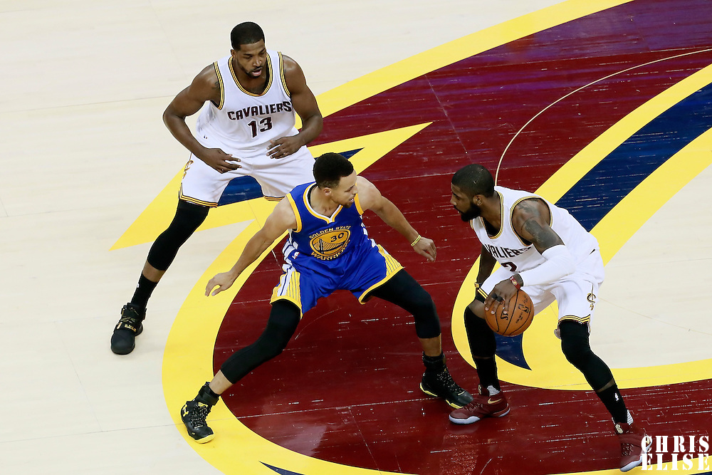 10 June 2016: Golden State Warriors guard Stephen Curry (30) defends on Cleveland Cavaliers guard Kyrie Irving (2) next to Cleveland Cavaliers center Tristan Thompson (13) during the Golden State Warriors 108-97 victory over the Cleveland Cavaliers, during Game Four of the 2016 NBA Finals at the Quicken Loans Arena, Cleveland, Ohio, USA.