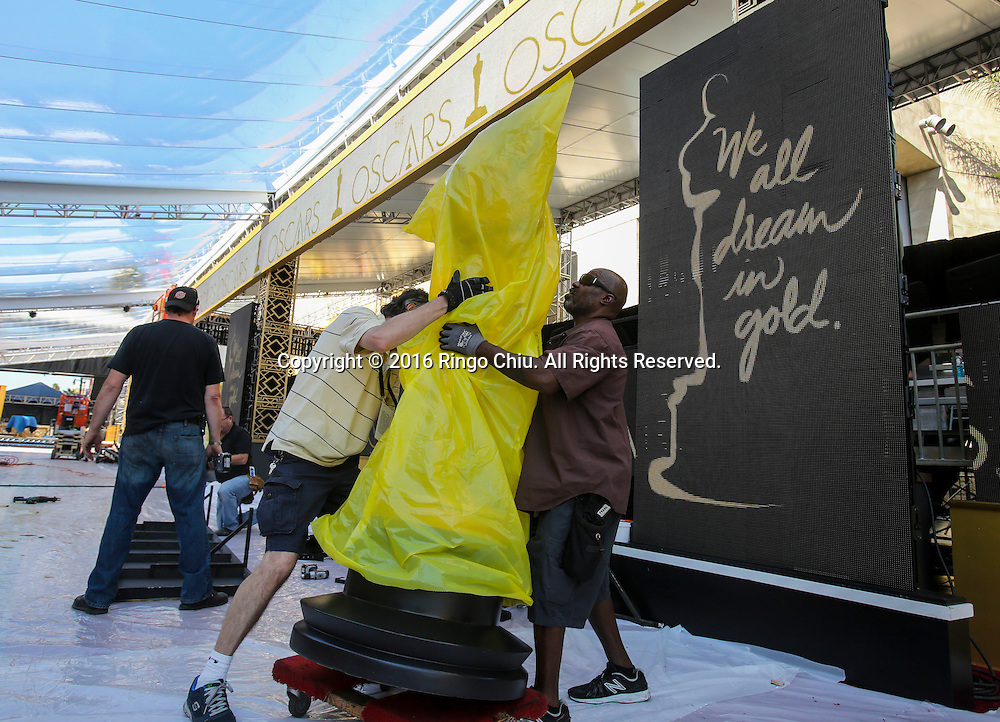 Workers transport an Oscar statue to the red carpet arrivals area in front of the Dolby Theatre Feb. 25, 2016 in Los Angeles. The 88th Academy Awards will be held Sunday, February 28, 2016. (Photo by Ringo Chiu/PHOTOFORMULA.com)<br /> <br /> Usage Notes: This content is intended for editorial use only. For other uses, additional clearances may be required.