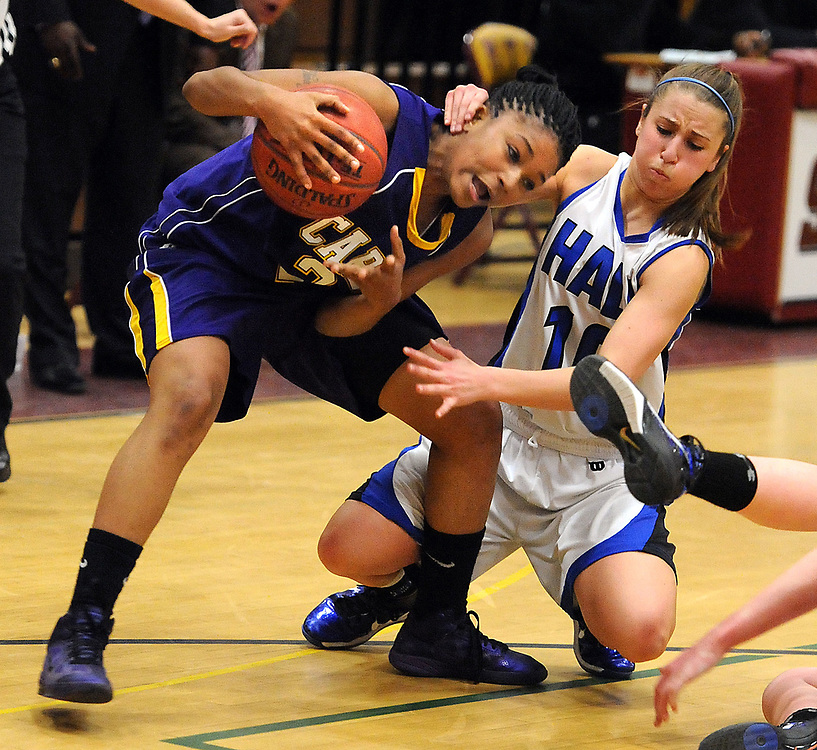 Class LL semifinals at Sheehan High School, Wallingford: Career, 52 over Hall, 27.  Fourth quarter: Career's Tanaya Atkinson left tangles wtih Sara Binkhorst right. Photo by Mara Lavitt/New Haven Register<br /> <br /> 3/14/11