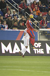 March 1, 2018 - Harrison, New Jersey, United States - Club Deportivo Olimpia Defender LUIS OVALLE (4) heads the ball over New York Red Bulls midfielder SEAN DAVIS (27) during the CONCACAF Champions league match at Red Bull Arena in Harrison, NJ.  NY Red Bulls defeat CD Olimpia 2-0  (Credit Image: © Mark Smith via ZUMA Wire)