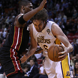March 10, 2011; Miami, FL, USA; Los Angeles Lakers power forward Pau Gasol (16) drives past Miami Heat power forward Chris Bosh (1) during the first quarter at the American Airlines Arena.  Mandatory Credit: Derick E. Hingle