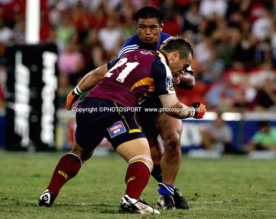 Lloyd Johansson leads with his sholder to stop Keven Mealamu during the 2006 Super 14 rugby union match between the Reds and the Auckland Blues at Suncorp Stadium, Brisbane, Australia, on Saturday 25 February, 2006.Blues defeated Reds 21-20. Photo: PHOTOSPORT