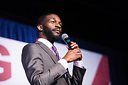 "BIRMINGHAM, AL – DECEMBER 11, 2017: On the eve of the Special General Election for Senate, Birmingham Mayor Randall Woodfin speaks to the crowd and endorses democratic candidate Doug Jones in a ""get out the vote"" rally.  CREDIT: Bob Miller for The New York Times"