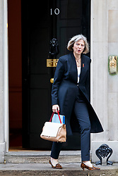 © Licensed to London News Pictures. 04/11/2014. LONDON, UK. Home Secretary Theresa May attending to a cabinet meeting in Downing Street on Tuesday 4 November 2014. Photo credit: Tolga Akmen/LNP