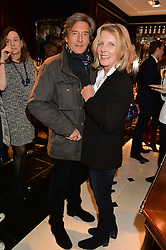 NIGEL HAVERS and his wife GEORGIANA at a party to celebrate the publication of 'A Designer's Life' by Nicky Haslam held at Ralph Lauren, 1 New Bond Street, London on 19th November 2014.
