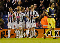 Photo: Leigh Quinnell.<br /> West Bromwich Albion v Derby County. Coca Cola Championship. 02/12/2006. John Hartson is congratulated by his West Brom teammates after a late goal.