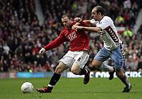 Photo: Paul Thomas.<br /> Manchester United v Aston Villa. The FA Cup. 07/01/2007.<br /> <br /> Wayne Rooney (L) of Man utd battles with Gavin McCann.
