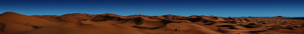 Deserted!<br /> The blasted sun drenched Erg Chebbi sand dunes, Morocco. <br /> Can you see the tiny camel train in this vast desolate but beautiful landscape.<br /> <br /> The EPSON International Pano Awards 2012<br /> BRONZE AWARD<br /> Amateur - Nature (including landscapes)<br /> Score: 72