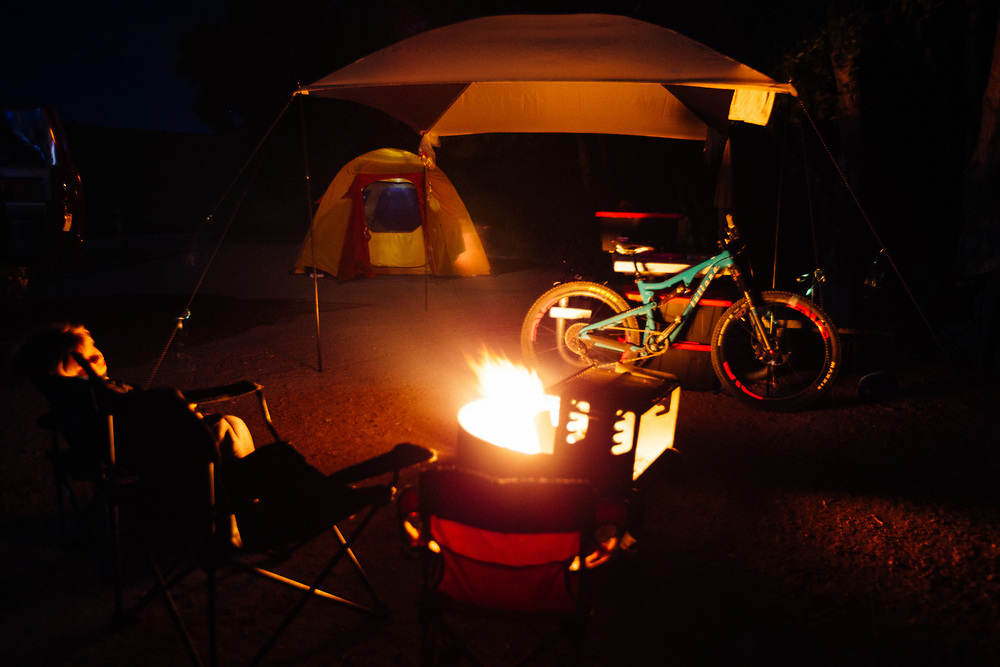Micah Goodrich (Age 6) falls asleep in his chair while roasting marshmallows after a day of mountain biking, fishing, and swimming.