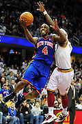 Feb. 25, 2011; Cleveland, OH, USA; New York Knicks point guard Chauncey Billups (4) shoots over Cleveland Cavaliers point guard Daniel Gibson (1) during the fourth quarter at Quicken Loans Arena. The Cavaliers beat the Knicks 115-109. Mandatory Credit: Jason Miller-US PRESSWIRE