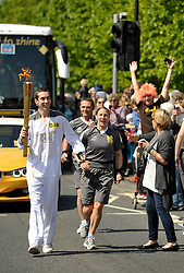 © Licensed to London News Pictures. 22/05/2012. Wells, Somerset, UK. The Olympic torch is carried through the town of Wells.  22 May 2012..Photo credit : Simon Chapman/LNP
