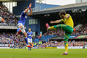 Kevin Bru takes one in the face from Bradley Johnson during the Sky Bet Championship Play Off First Leg match between Ipswich Town and Norwich City at Portman Road, Ipswich, England on 9 May 2015. Photo by Simon Davies.