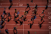 A plethora of high school girls compete in one of the many 4x400-meter races during the first day of competition at 124th annual Pennsylvania Relays Carnival held at the University of Pennsylvania's Franklin Field in Philadelphia, Pennsylvania on April 26, 2018. Athletes from more than 200 colleges, 1,000 high schools, and professionals competing in the three-day festival.