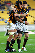 Apoua Stewart congratulates Victor Vito on scoring for Wellington. ITM Cup rugby union - Wellington Lions v Northland at Westpac Stadium, Wellington, New Zealand on Saturday, 28 August 2010. Photo: Dave Lintott/PHOTOSPORT