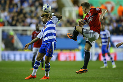 Tom Cairney of Fulham clears the ball under pressure from Daniel Williams of Reading - Mandatory by-line: Jason Brown/JMP - 16/05/2017 - FOOTBALL - Madejski Stadium - Reading, England - Reading v Fulham - Sky Bet Championship Play-off Semi-Final 2nd Leg