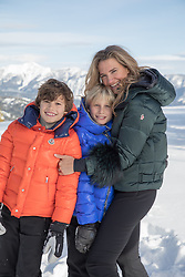 mother and two boys together in Winter coats