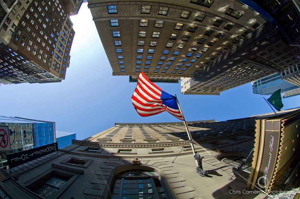 United States of America flag flying from the side of the Roosevelt Hotel building in Manhattan, New York City.
