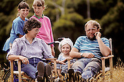 Paleontologists Tom and Pat Rich relax with their family at Dinosaur Cove camp near Cape Otway, southern Australia.  Dinosaur Cove is the world's first mine developed specifically for paleontology, normally the scientists rely on commercial mining to make the excavations. The site is of particular interest as the fossils found date from about 100 million years ago, when Australia was much closer to the South Pole than today. MODEL RELEASED [1989].