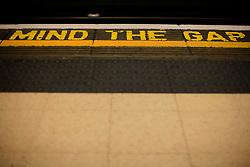 UK ENGLAND LONDON 4NOV12 - Mind the gap warning on the edge of a platform at Piccadilly Circus station on the London Underground, Bakerloo line.....jre/Photo by Jiri Rezac..© Jiri Rezac 2012
