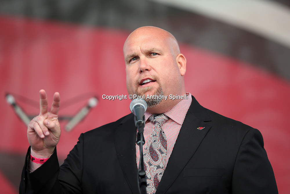 Arizona Cardinals general manager Steve Keim gives a victory sign as he speaks during a pep rally on the Great Lawn before the Arizona Cardinals NFL NFC Divisional round playoff football game against the Green Bay Packers on Saturday, Jan. 16, 2016 in Glendale, Ariz. The Cardinals won the game in overtime 26-20. (©Paul Anthony Spinelli)