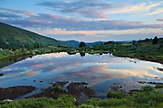 A rather large pond just east of Mount Bierstadt in the Mount Evans Wilderness reflects the last light of the day.