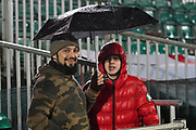 Middlesbrough fans sheltering under an umbrella before the The FA Cup match between Newport County and Middlesbrough at Rodney Parade, Newport, Wales on 5 February 2019.