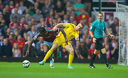 LONDON, ENGLAND - Saturday, September 20, 2014: Liverpool's Jordan Henderson in action against West Ham United during the Premier League match at Upton Park. (Pic by David Rawcliffe/Propaganda)