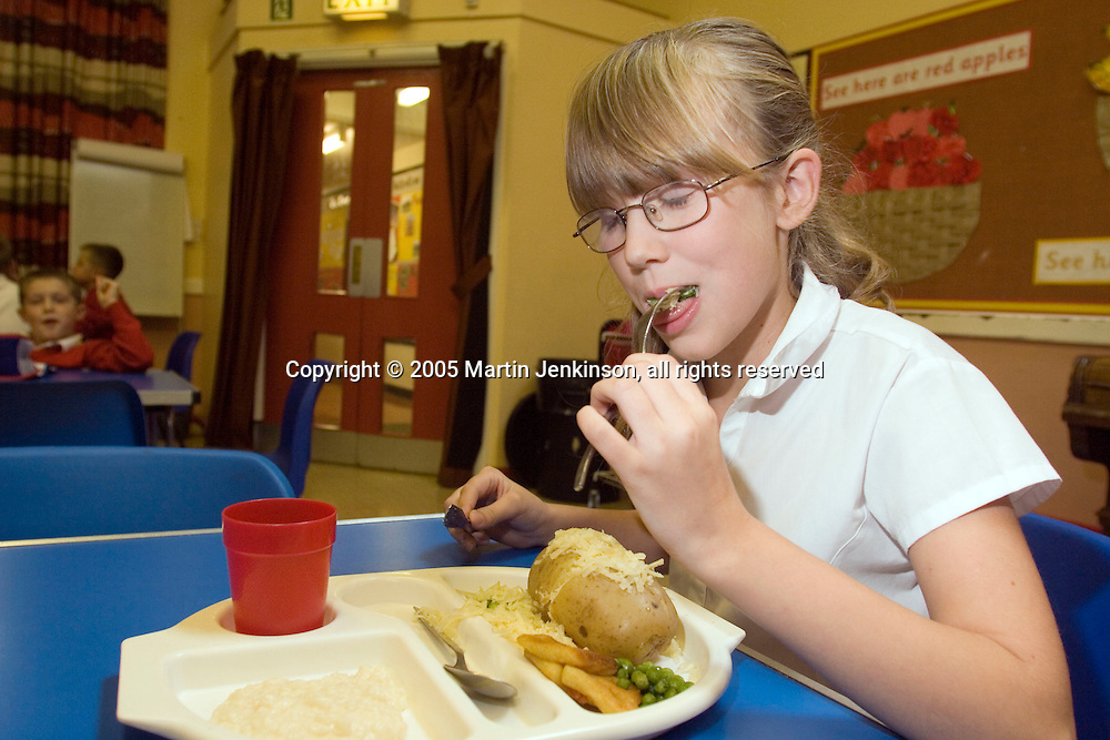Young girl enjoying a healthy school meal at Paisley Primary School. Hull..© Martin Jenkinson, tel/fax 0114 258 6808 mobile 07831 189363 email martin@pressphotos.co.uk. Copyright Designs & Patents Act 1988, moral rights asserted credit required. No part of this photo to be stored, reproduced, manipulated or transmitted to third parties by any means without prior written permission