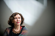 Photograph of Azar Nafisi, Author and visiting Professor and the executive director of Cultural Conversations at the Foreign Policy Institute of Johns Hopkins University's School of Advanced International Studies. Photo taken at the West End Library in Washington DC on 1/29/15.
