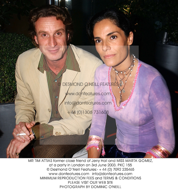 MR TIM ATTIAS former close friend of Jerry Hall and MISS MARTA GOMEZ, at a party in London on 3rd June 2003.PKC 155