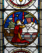 Detail stained glass window depicting biblical healing scenes, raising daughter  Jairus by Clayton and Bell, 1872 in church of Saint Mary, Potterne, Wiltshire, England