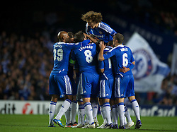 LONDON, ENGLAND - Wednesday, October 19, 2011: Chelsea's Raul Meireles is mobbed by his team-mates after scoring the opening goal during the UEFA Champions League Group E match at Stamford Bridge. (Photo by Chris Brunskill/Propaganda)