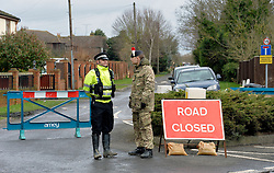Police and Army guard roads in Wraysbury, Berks against any potential looting of properties, United Kingdom, Wednesday 12th February 2014. Picture by David Dyson / i-Images
