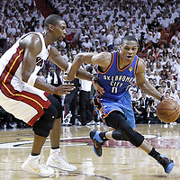 21 June 2012: Oklahoma City Thunder point guard Russell Westbrook (0) drives past Miami Heat power forward Chris Bosh (1) during the second quarter of Game 5 of the 2012 NBA Finals, at the AmericanAirlinesArena, Miami, Florida, USA.