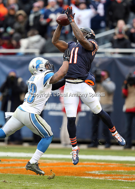 Chicago Bears wide receiver Josh Bellamy (11) leaps and catches a 34 yard touchdown pass in the end zone that ties the third quarter score at 10-10 while covered by Detroit Lions rookie cornerback Quandre Diggs (28) during the NFL week 17 regular season football game against the Detroit Lions on Sunday, Jan. 3, 2016 in Chicago. The Lions won the game 24-20. (©Paul Anthony Spinelli)