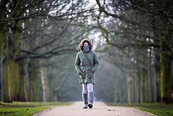 "© Licensed to London News Pictures. 25/02/2018. Leeds UK. 12 year old Cerys wraps up warm for a walk through Temple Newsam park in Leeds this morning as the temperature begins to drop across the UK ahead of the expected arrival of a cold blast known as ""the beast from the east"" from Russia. Photo credit: Andrew McCaren/LNP"