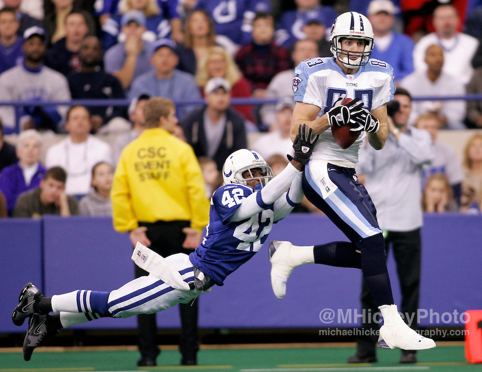 Tennessee's Drew Bennett goes up for an eventual touchdown reception against the Colts' Jason David during first half action at the RCA Dome in Indianapolis, IN.