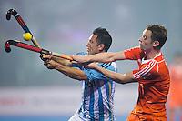BHUBANESWAR  (INDIA) -    Nederland vs Argentinie (3-0) .  Champions Trophy Hockey. Mirco Pruijser i duel met de Pedro Ibarra van Argentinie.  ANP KOEN SUYK