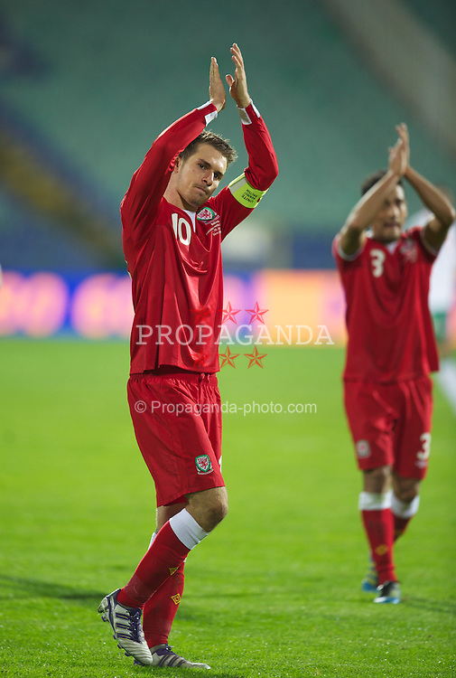 SOFIA, BULGARIA - Tuesday, October 11, 2011: Wales' captain Aaron Ramsey applauds the supporters after his side's 1-0 victory over Bulgaria during the UEFA Euro 2012 Qualifying Group G match at the Vasil Levski National Stadium. (Pic by David Rawcliffe/Propaganda)