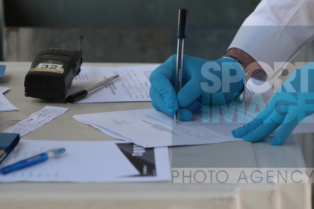 A man completes auto certification documents before entering the stadium for the Serie A match at Stadio Grande Torino, Turin. Picture date: 20th June 2020. Picture credit should read: Jonathan Moscrop/Sportimage