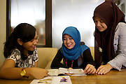 Catharina Ikawati (left) selling make up.<br /> <br /> Catharina is 27 years old <br /> and is already running two successful businesses.<br /> <br /> The first, a German language school, she established three years ago to teach student who were going to Germany on a government approved au pair scheme.<br /> <br /> After signing up to the Usaha Wanita app she started to think about how she could use her spare time more effectively and so she became a make-up salesperson. Not only does she sell herself, she recruits others sellers so she earns commission in a number of ways. With her increased profit she has been able to start supporting her parents with their daily living costs and has bought herself a car.