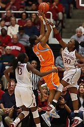 Dec 20, 2011; Stanford CA, USA;  Tennessee Lady Volunteers forward/center Vicki Baugh (21) is fouled while shooting by Stanford Cardinal forward Nnemkadi Ogwumike (30) during the second half at Maples Pavilion.  Stanford defeated Tennessee 97-80. Mandatory Credit: Jason O. Watson-US PRESSWIRE