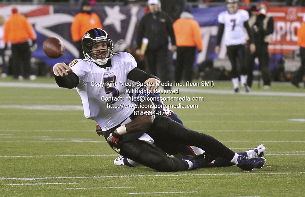 Jan. 22, 2012 - Foxboro, MA, USA - Baltimore Ravens Joe Flacco is sacked for a 12-yard loss by New England Patriots James Ihedigbo in the 3rd quarter of their AFC Championship game in Foxboro, Massachusetts, Sunday, January 22, 2012. Patriots won, 23-20.